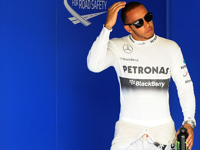 Lewis Hamilton takes a break during the qualifying session at Hungaroring on July 27, 2013