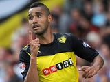 Watford's Lewis McGugan celebrates after scoring his team's fourth goal against Bournemouth on August 10, 2013