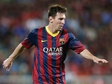 Barcelona's Lionel Messi in action against Thailand XI during a friendly match on August 7, 2013