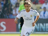 Real's Luca Modric in action during a friendly match against Everton on August 3, 2013