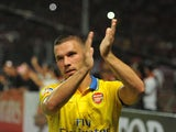 Lukas Podolski of Arsenal FC greet the fans after the match between Arsenal and the Indonesia All-Stars on July 14, 2013