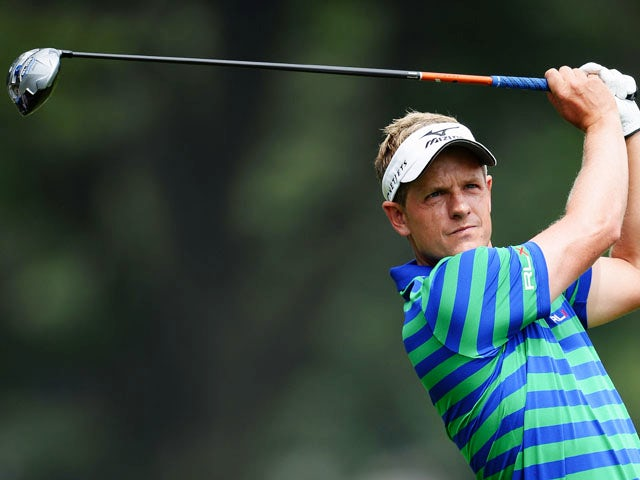 Luke Donald of England hits a shot during a practice round prior to the start of the 95th PGA Championship at Oak Hill Country Club on August 7, 2013