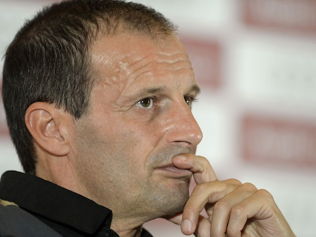 Milan's Massimiliano Allegri at a press conference on July 30, 2013