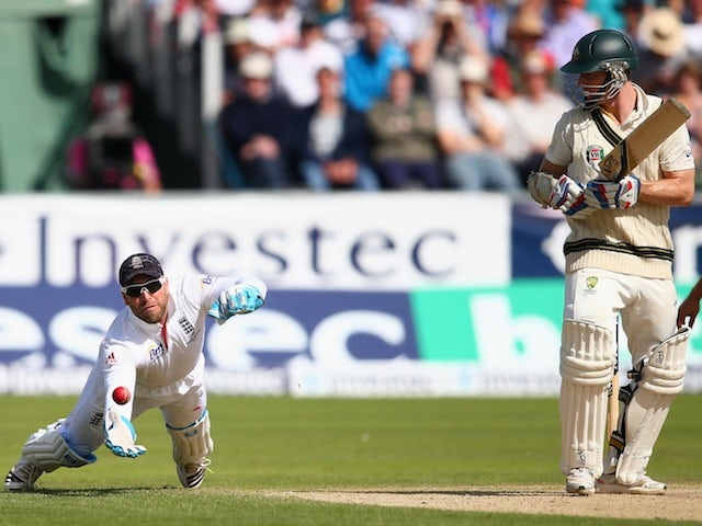 England's Matt Prior dives forward to catch the ball and dismiss Australia's Chris Rogers on day three of the fourth Ashes Test