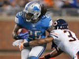 Mikel Leshoure of the Detroit Lions tries to get around the tackle of Anthony Walters of the Chicago Bears on December 30, 2012