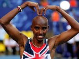 Mo Farah celebrates after winning gold in the Men's 10000 metres final at the World Athletics Championships in Moscow on August 10, 2013