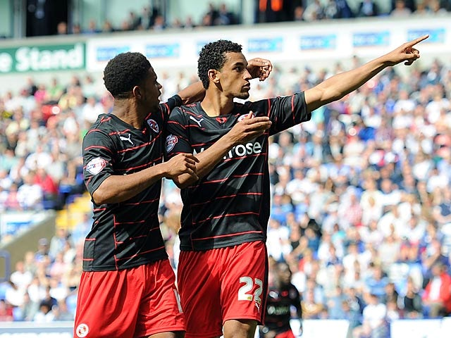 Reading's Nick Blackman is congratulated by team mate Gareth McCleary after scoring the equaliser against Bolton on August 10, 2013