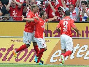 Ten-man Wolfsburg stutter to defeat