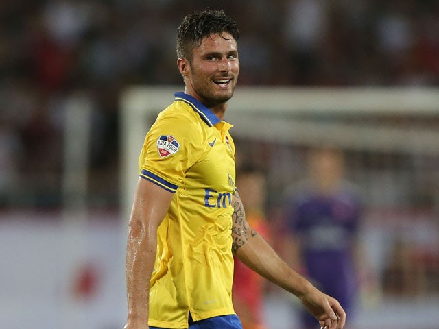 Arsenal striker Oliver Giroud reacts afetr missing a shot at goal against Vietnam during the international friendly match between Vietnam and Arsenal FC at My Dinh National Stadium on July 17, 2013