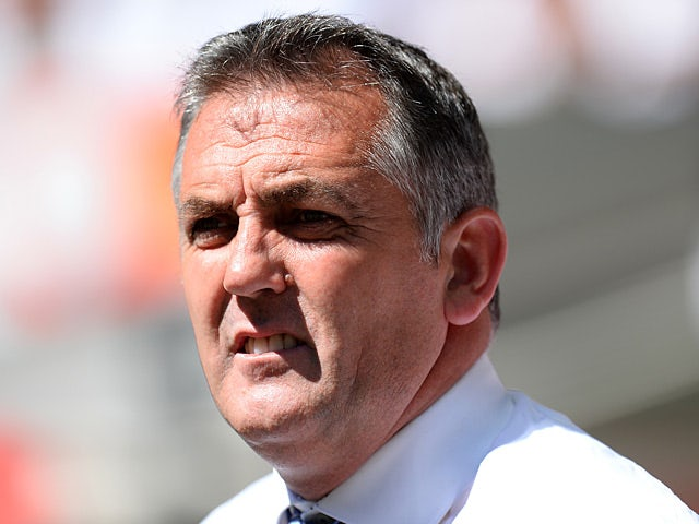 Wigan Athletic manager Owen Coyle prior to kick-off at the Community Shield match against Manchester United on August 11, 2013