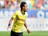 Borussia Dortmund's Pierre-Emerick Aubameyang celebrates after scoring the opening goal against Augsburg on August 10, 2013