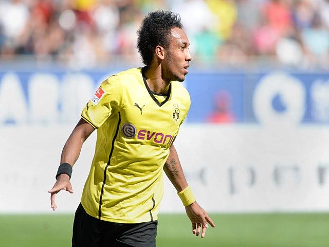 Borussia Dortmund's Pierre-Emerick Aubameyang celebrates after scoring the opening goal against Augsburg on August 10, 2013