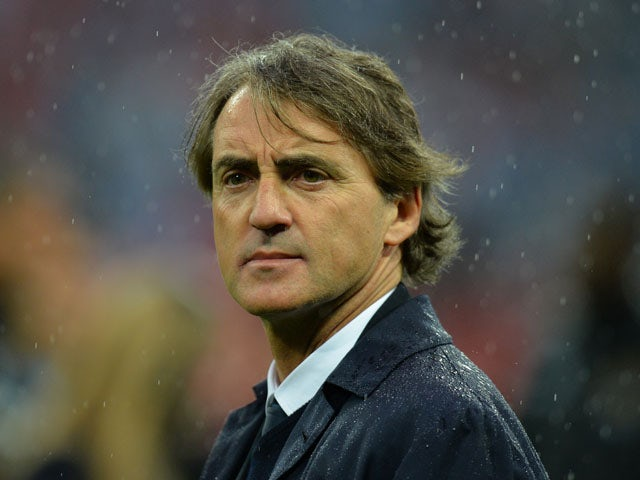 Manchester City's Italian manager Roberto Mancini reacts after his team lost the English FA Cup final football match between Manchester City and Wigan Athletic on May 11, 2013