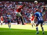 Manchester United striker Robin van Persie heads in the opener against Wigan Athletic in the Community Shield on August 11, 2013