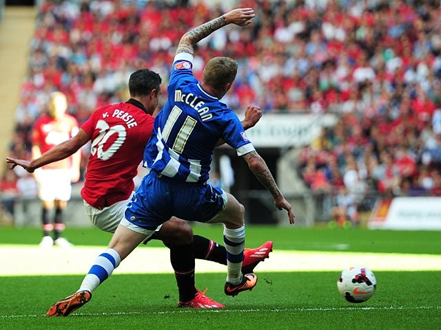 Manchester United's Robin Van Persie scores his team's second goal against Wigan during the Community Shield on August 11, 2013