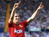 Robin van Persie of Manchester United celebrates as he scores their fourth goal during the Barclays Premier League match between West Bromwich Albion and Manchester United on May 19, 2013