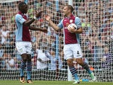 Villa's Ron Vlaar is congratulated by team mate Christian Benteke after scoring his team's second goal against Malaga during a friendly match on August 10, 2013