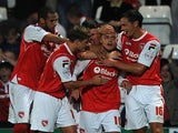 Morecambe players surround Ryan Williams after his goal against Wolves on August 6, 2013
