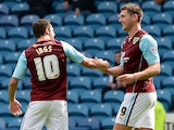 Burnley's Sam Vokes is congratulated by team mate Danny Ings after scoring his team's second goal against Sheffield Wednesday on August 10, 2013