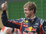 German F1 driver Sebastian Vettel gives the thumb up as celebration of his pole position at the Interlagos racetrack in Sao Paulo on November 26, 2011