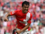 Mainz' Shinji Okasaki celebrates after scoring his team's second goal against Stuttgart on August 11, 2013