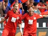 Leverkusen's Stefan Kiessling is congratulated by team mate Heung Min Son after scoring against Freiburg on August 10, 2013