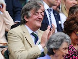 Stephen Fry attend the Ladies' Singles second round match between Eugenie Bouchard of Canada and Ana Ivanovic of Serbia on day three of the Wimbledon Lawn Tennis Championships on June 26, 2013