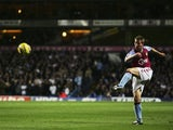 Thomas Hitzlsperger shoots for goal against Tottenham Hotspur.