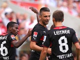Stuttgart's Vedad Ibisevic is congratulated by team mates after scoring the equaliser against Mainz on August 11, 2013