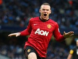 Wayne Rooney of Manchester United celebrates the winning goal during the Barclays Premier League match between Manchester City and Manchester United on December 9, 2012