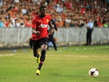 Manchester United's Wilfried Zaha controls the ball against Kitchee during their football friendly match at Hong Kong stadium on July 29, 2013