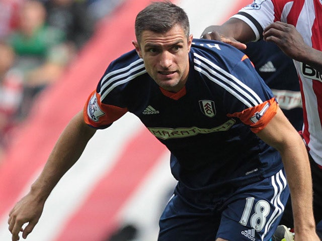 Fulham's Aaron Hughes in action against Sunderland on August 17, 2013