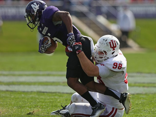 Adam Replogle #98 of the Indiana Hoosiers tackles Venric Mark #5 of the Northwestern Wildcats at Ryan Field on September 29, 2012