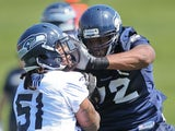 Alex Barron of the Seattle Seahawks battles for the ball during minicamp at the Virginia Mason Athletic Center on May 11, 2012