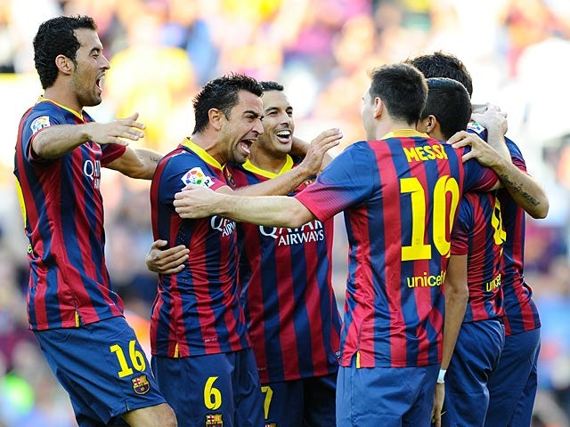 Barcelona's Alexis Sanchez is congratulated by team mates after tapping in the opening goal against Levante on August 18, 2013