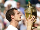 Andy Murray of Great Britain poses with the Gentlemen's Singles Trophy following his victory in the Gentlemen's Singles Final match against Novak Djokovic of Serbia on day thirteen of the Wimbledon Lawn Tennis Championships at the All England Lawn Tennis