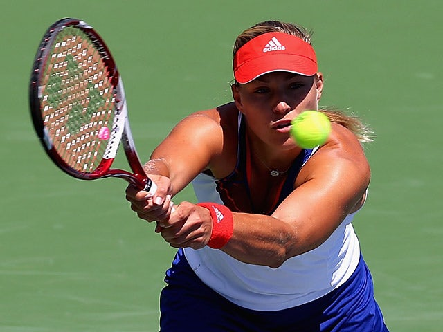 Angelique Kerber in action against Alisa Kleybanova during the Western & Southern Open on August 14, 2013