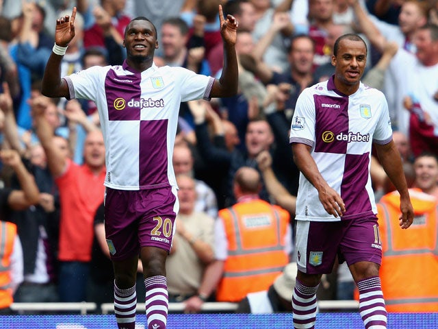 Christian Benteke of Aston Villa celebrates scoring his side's second goal during the Barclays Premier League match between Arsenal and Aston Villa at Emirates Stadium on August 17, 2013
