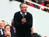 Aston Villa manager Paul Lambert shouts orders to his team during the Barclays Premier League match between Arsenal and Aston Villa at Emirates Stadium on August 17, 2013