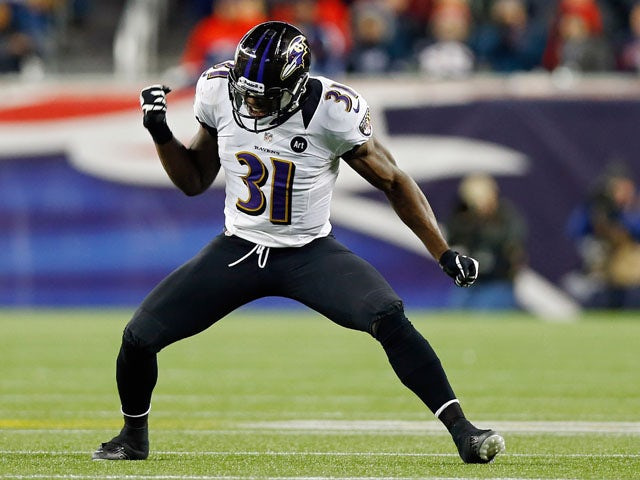 Bernard Pollard #31 of the Baltimore Ravens celebrates a fumble recovery against Stevan Ridley #22 of the New England Patriots in the fourth quarter during the 2013 AFC Championship game at Gillette Stadium on January 20, 2013