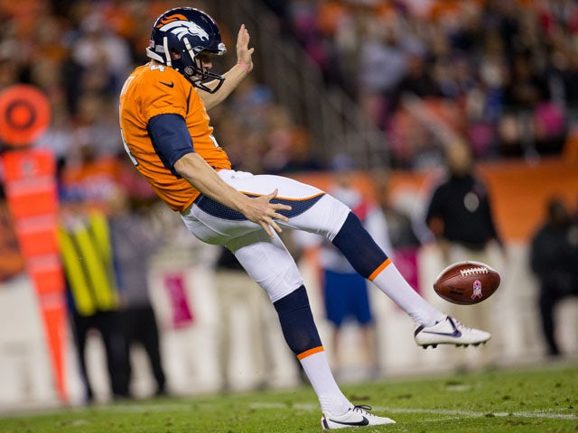 Punter Britton Colquitt of the Denver Broncos punts the ball against the New Orleans Saints at Sports Authority Field Field at Mile High on October 28, 2012