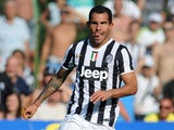 Carlos Tevez of FC Juventus in action during the pre-season friendly match between FC Juventus A and FC Juventus B on August 11, 2013