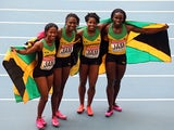 Jamaica pose after winning gold in the Women's 4x100 metres final at the World Championships in Moscow on August 18, 2013