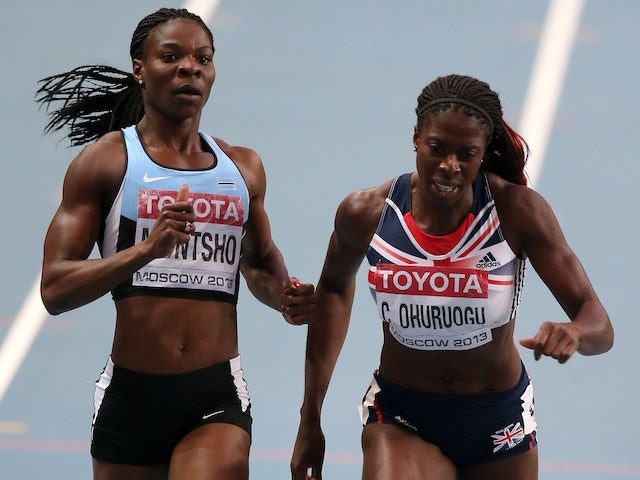Christine Ohuruogu dips across the line to win 400m gold at the World Championships in Moscow on August 12, 2013