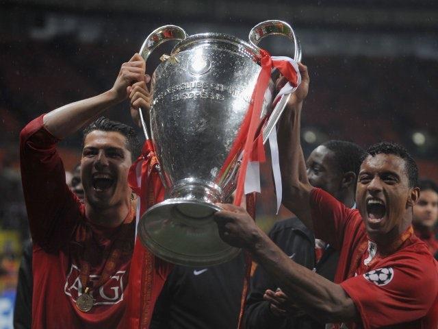 Cristiano Ronaldo and Nani lift the Champions League trophy.