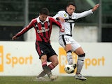 Davide Pacifico of AC Milan for the ball with Andrea Lenzi Pappaianni of Parma FC during the Viareggio Juvenile Cup match between AC Milan and Parma FC at Stadio Torquato Bresciani on February 23, 2013