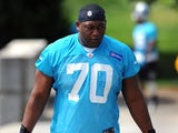 Edmund Kugbila of the Carolina Panthers walks toward the team's practice facility during the Panthers Rookie Camp on May 11, 2013