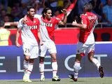 Monaco's Emmanuel Riviere is congratulated by team mates Radamel Falcao and Jeremy Toulalan after scoring his team's second goal against Montpellier on August 18, 2013
