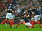 James Morrison of Scotland celebrates with team-mates after scoring a goal during the International Friendly match between England and Scotland at Wembley Stadium on August 14, 2013