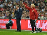 Scotland manager Gordon Strachan shouts from the touchline during the international friendly football match between England and Scotland at Wembley Stadium in London on August 14, 2013